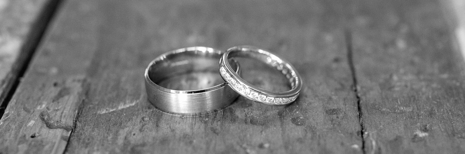 Gray scale image of couples wedding rings
