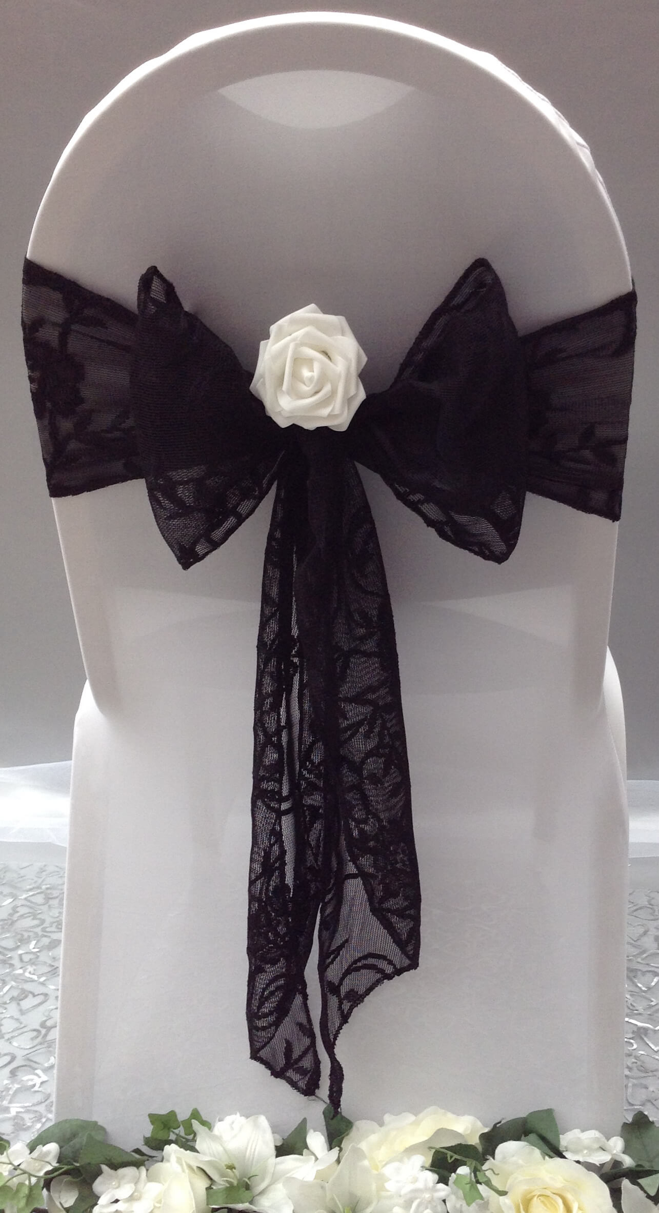 Black lace sash with white flower