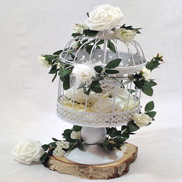 White bird cage centre piece with white roses