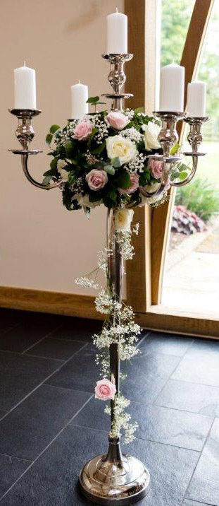 Tall silver candelabra with floral decoration