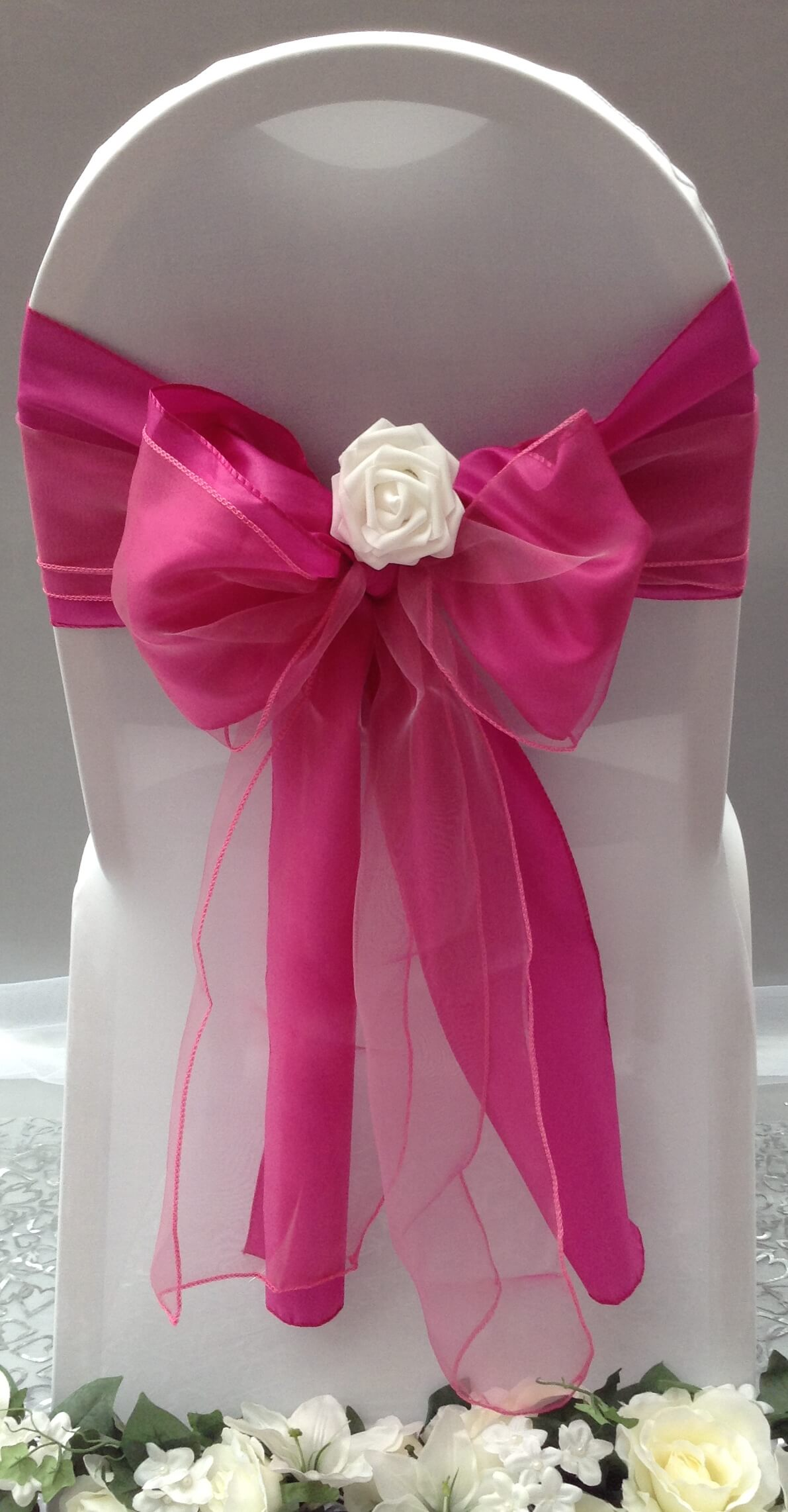 Double pink sash with white flower
