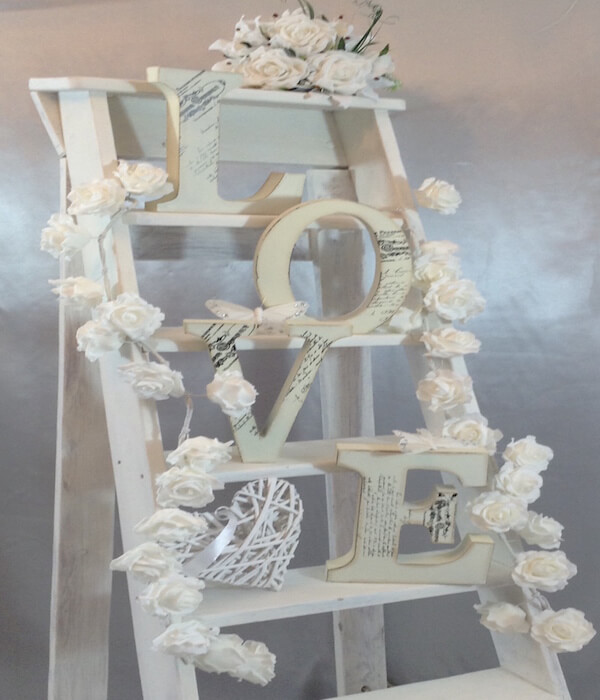 white ladder with wooden letters spelling love