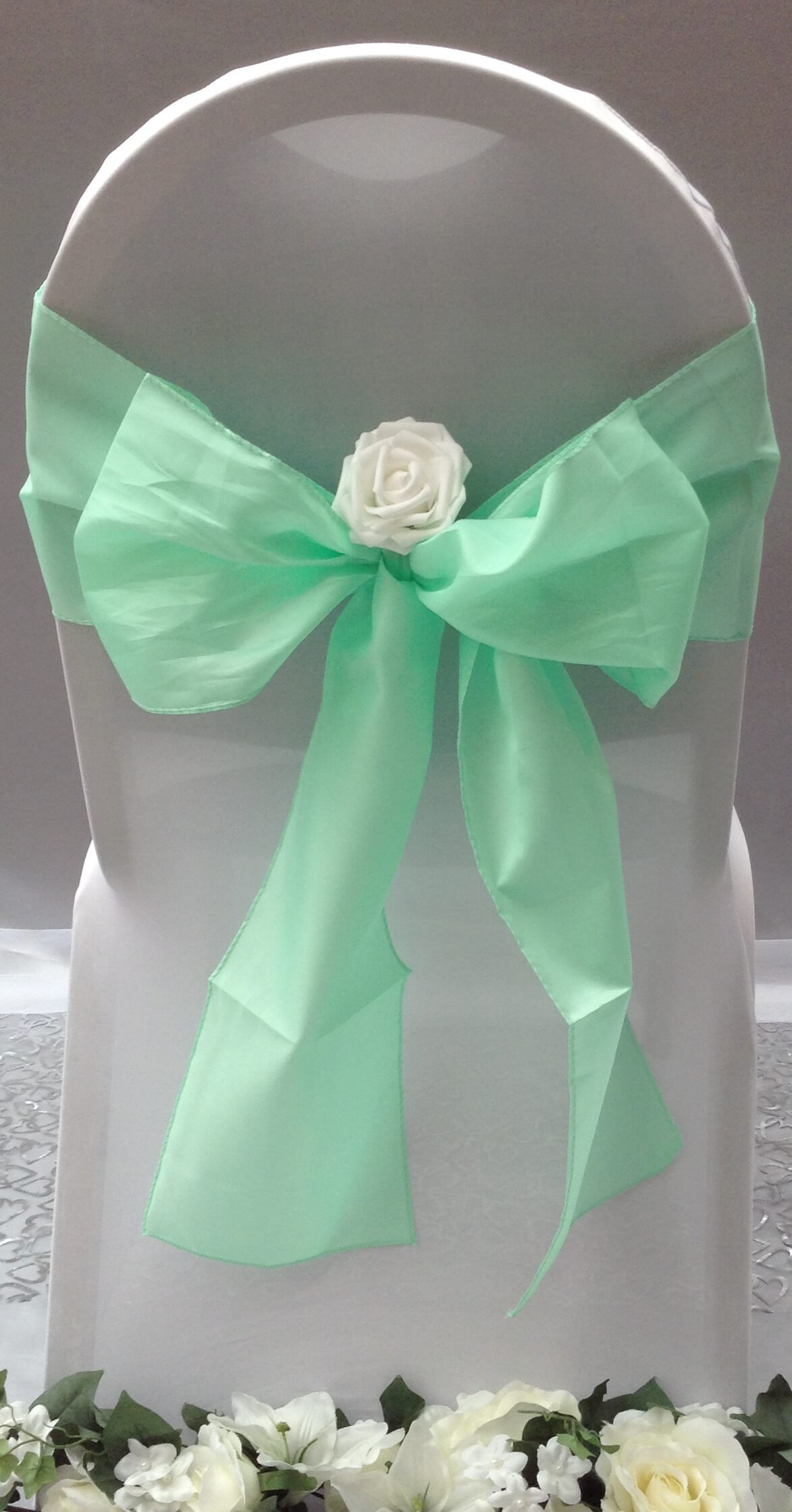 Pastel green sash with white flower