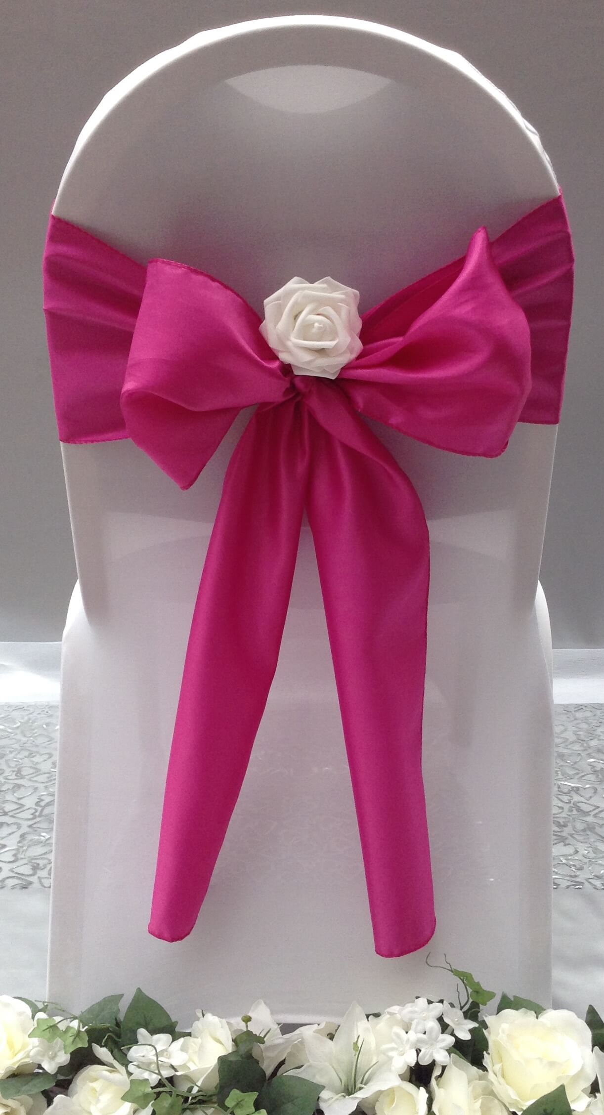 pink satin sash with white flower