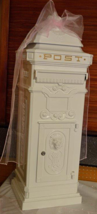 white and gold postbox