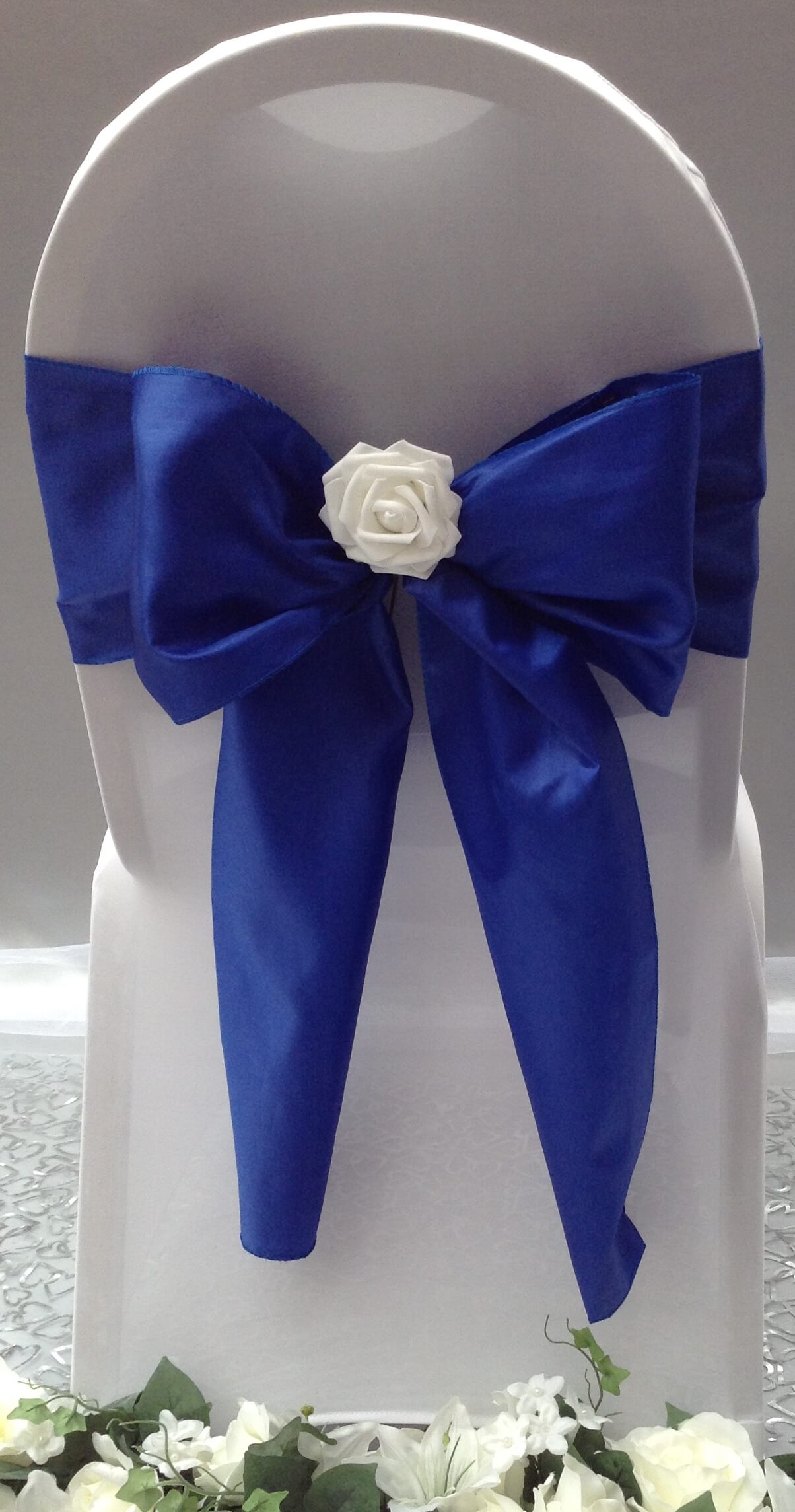 Royal blue satin sash with white flower